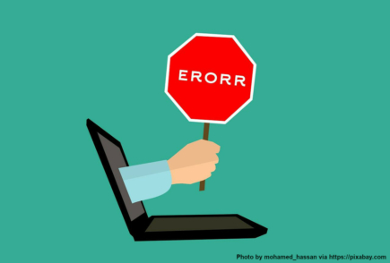 A warning sign coming out of a laptop, saying: ERROR